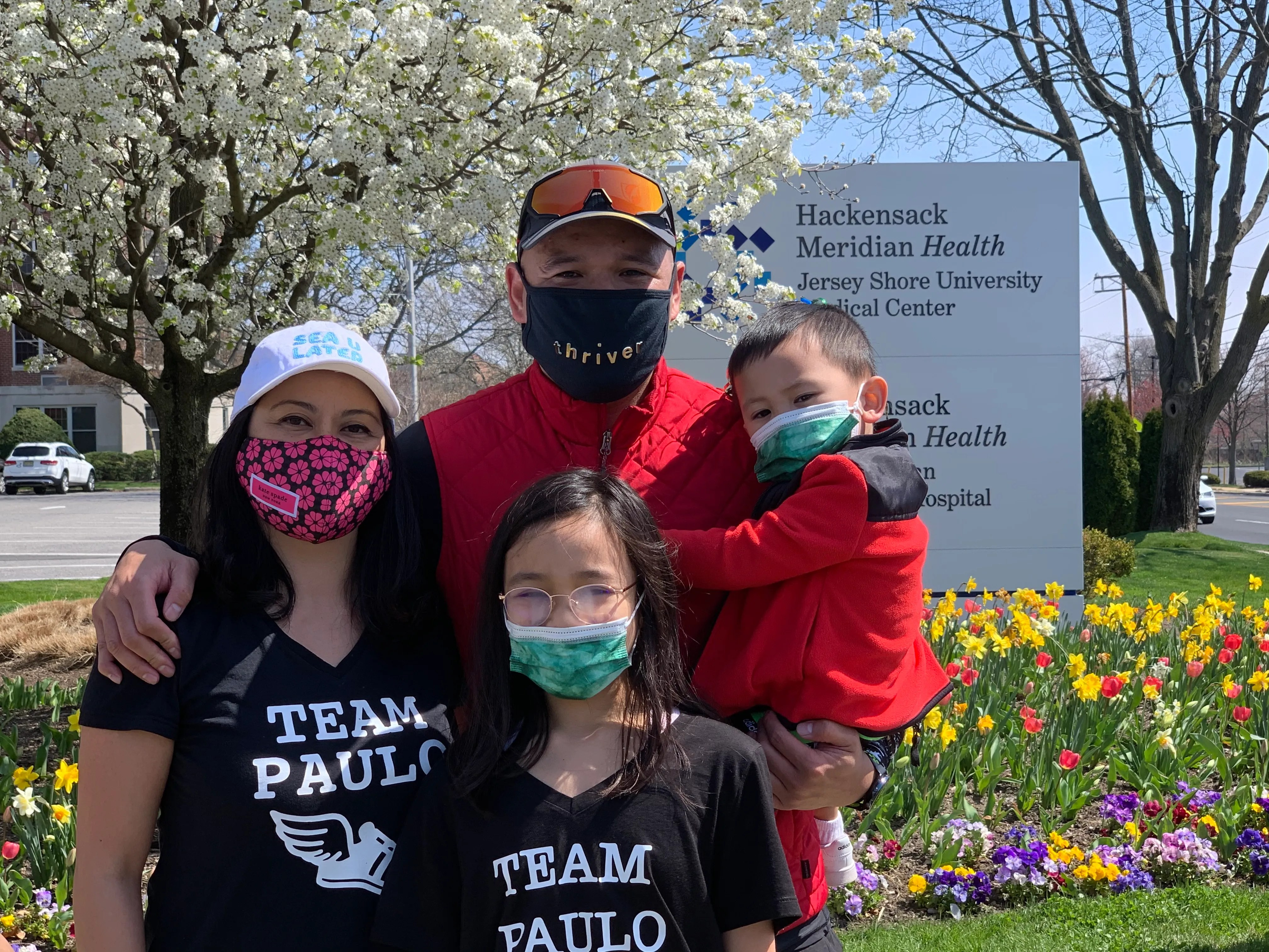 Paulo Santos (top center) with wife Christine Santos (left) and their children Ava (bottom center) and Paulo Jr. at Jersey Shore University Medical Center after Paulo's 20-mile run on Saturday.