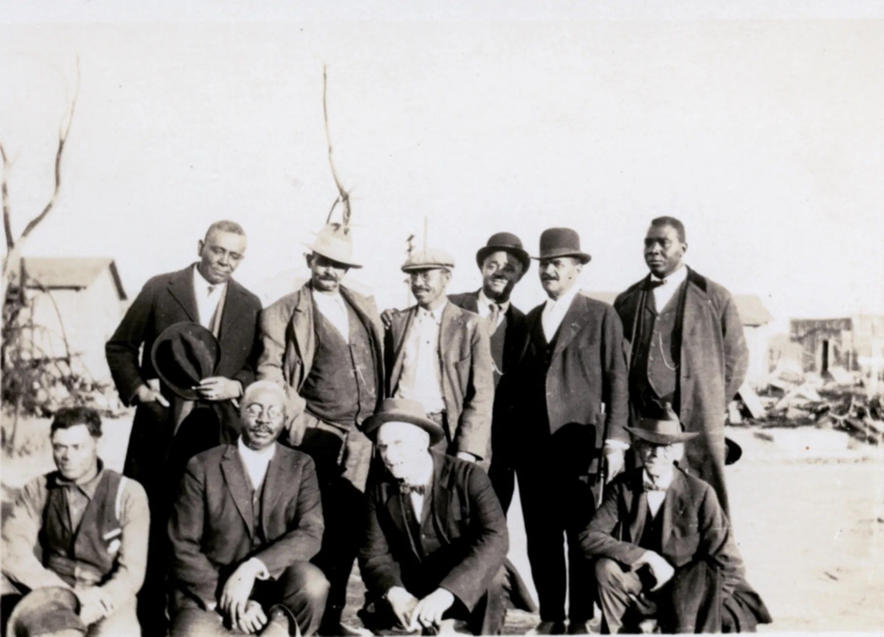The members of the Colored Citizens Relief Committee and East End Welfare Board following the 1921 Tulsa Race Massacre.  The individuals standing include (left to right) Williams, Phillips, Esta