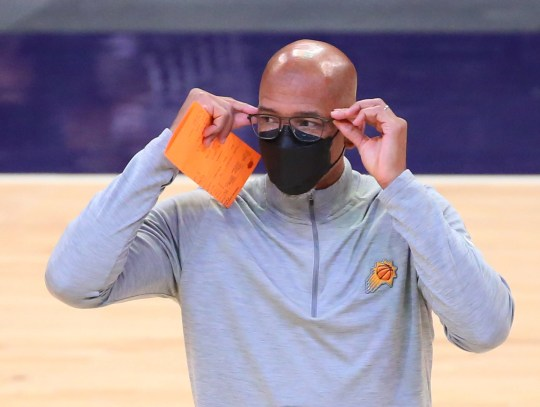 Phoenix Suns head coach Monty Williams adjust his glasses during a timeout against the Miami Heat during the first quarter in Phoenix April 13, 2021.