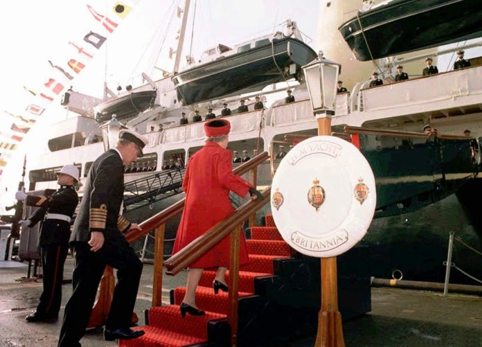 Queen Elizabeth II and Prince Philip board The Royal Yacht Britannia on Dec. 11, 1997, at Portsmouth before the vessel was retired after 44 years of service. The monarch was reported to have been teary as she toured the rooms one last time.