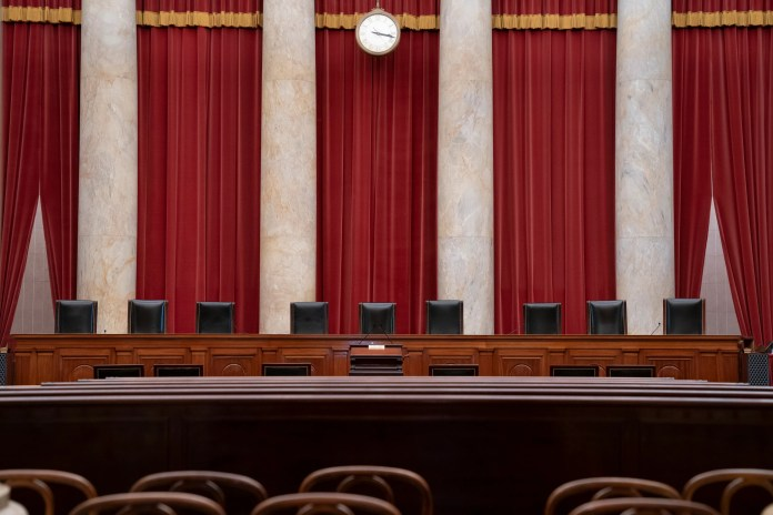 In this June 24, 2019 file photo, the empty courtroom is seen at the U.S. Supreme Court in Washington.