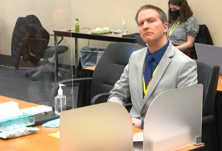 In this image from video, former Minneapolis police Officer Derek Chauvin listens as his defense attorney Eric Nelson gives closing arguments as Hennepin County Judge Peter Cahill preside Monday, April 19, 2021, in the trial of Chauvin at the Hennepin County Courthouse in Minneapolis.