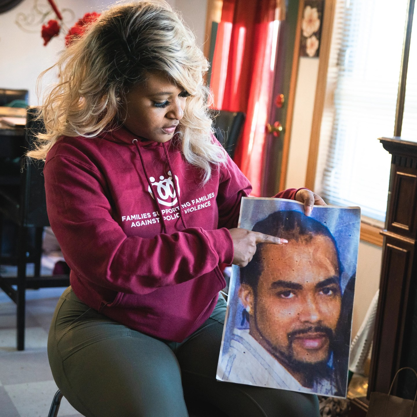 At her home in Minneapolis on Thursday, March 11, 2021, Toshira Garraway points to a spot on her fiance Justin Teigen's head that was split open after he died shortly after an interaction with the police.