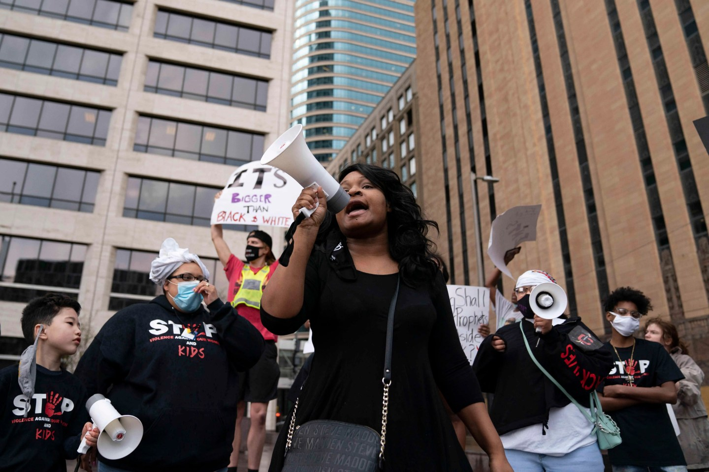 Toshira Garraway leads chants during a protest in front of the Minneapolis Government Center in Minneapolis, MN on April 6, 2021. Garraway founded the organization Families Supporting Families Against Police Violence after her fiance, Justin Teigen, was was found dead at a recycling facility after he was pulled over by St. Paul police.