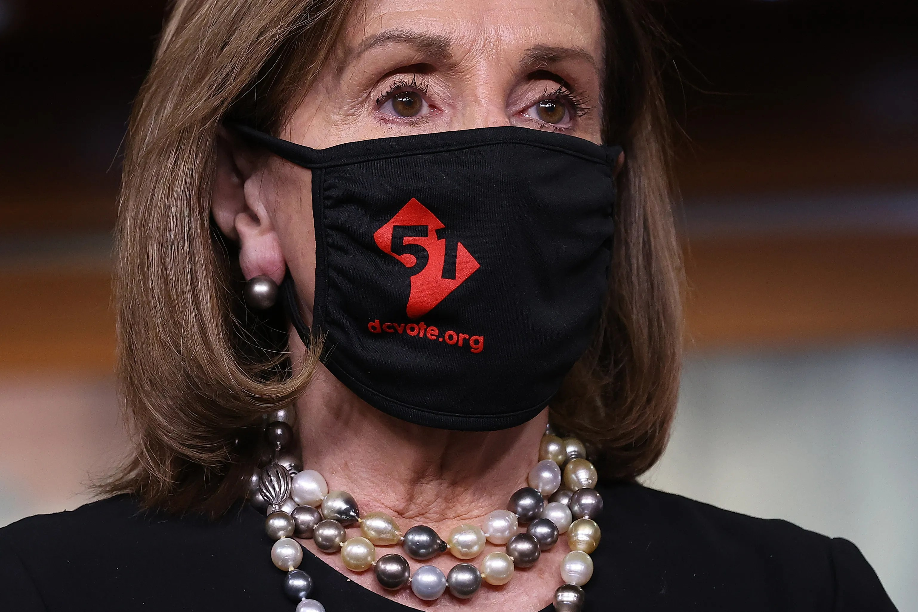 """WASHINGTON, DC - APRIL 21: Speaker of the House Nancy Pelosi (D-CA) wears a `` 51 '' face mask during a press conference on the state of the District of Columbia at the U.S. Capitol on April 21, 2021 in Washington, DC.  The House of Representatives will vote on HR51 on Thursday, """"Washington, DC Admission Act,"""" which would grant statehood to residents of the District of Columbia.  (Photo by Chip Somodevilla / Getty Images) ORG XMIT: 775646980 ORIG FILE ID: 1313691561"""