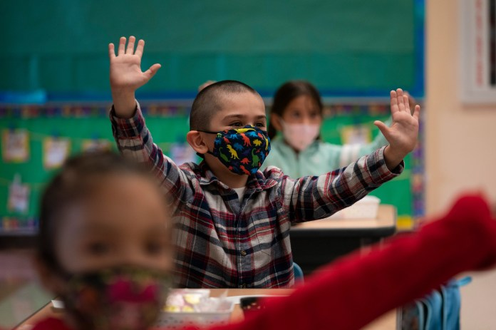 Kindergarten students return for the first day of in-person learning at Maurice Sendak Elementary School in Los Angeles on April 13, 2021. Most large districts in California didn't reopen for in-person instruction until the middle of April -- more than a year after the pandemic shuttered buildings.
