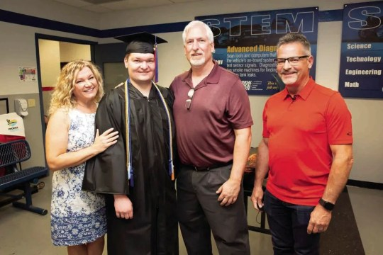 Graduate Brandon Zimmermann with his parents, Nadine and Paul, and Fritz Pfauth, regional service manager at Sunstate Equipment, at graduation at Universal Technical Institute in Avondale on April 23, 2021.