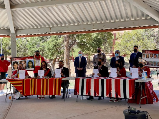 Navajo leaders alongside FBI officials hold up the signed proclamation marking May 5 as Navajo Nation Missing and Murdered Indigenous People's Day. Tribal leaders signed the proclamation in Window Rock on May 5, 2021.