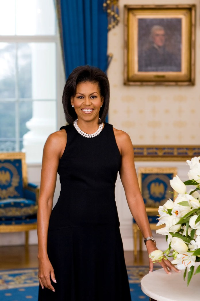 In this handout image provided by the White House, First Lady Michelle Obama poses for her official portrait in the Blue Room of the White House February 2009 in Washington, DC.