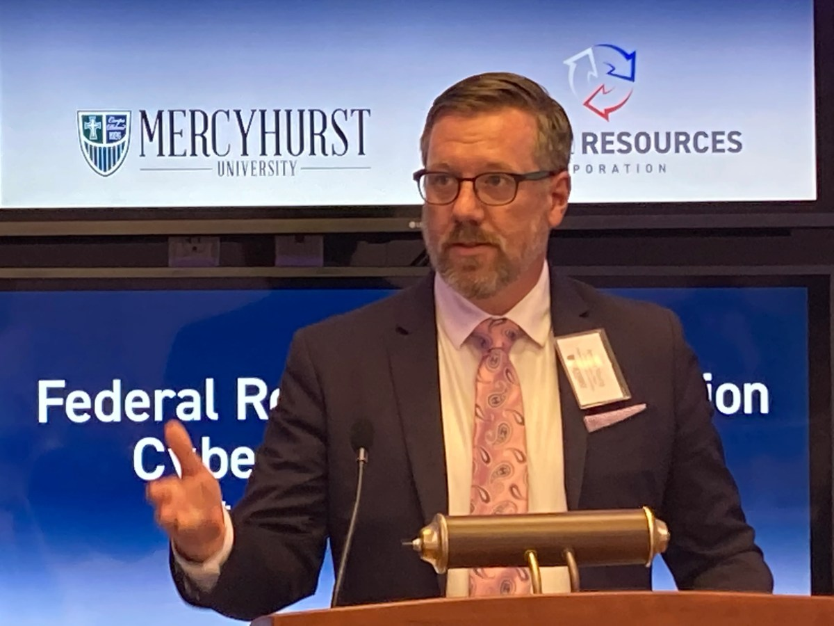 Jeremy Young, CEO of Erie-based Federal Resources Corp., speaks Monday at Mercyhurst University. He announced that his company is the new sponsor of the cyber labs at Mercyhurst University.