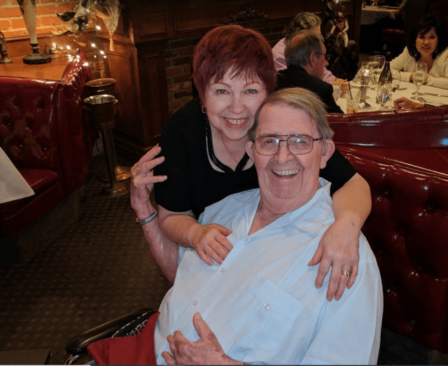 Melody Taylor Stark and her husband, Bill, smile for a photo on their wedding anniversary in 2019.