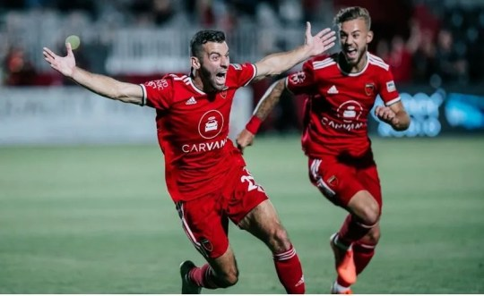 Phoenix Rising FC's Joey Calistri (left) celebrates the game-tying goal against SD Loyal Saturday at Wild Horse Pass stadium on June 5, 2021.