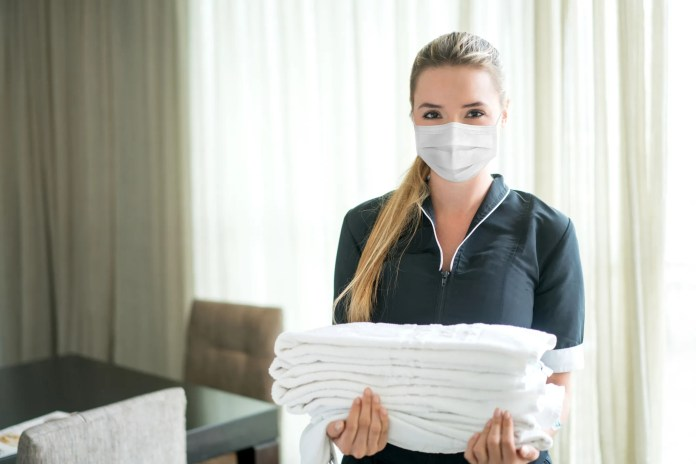 During COVID, many hotel properties have only serviced their rooms between guests. That includes emptying trash, changing towels and linens and making beds.