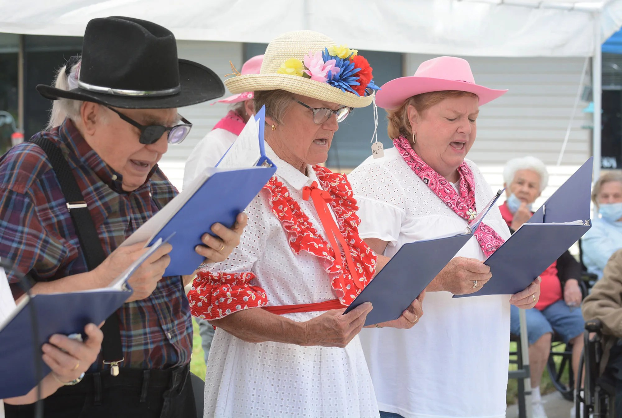 Edgar Saigneault, 88, left, Ginny Smelsee, 77, aka Minnie Pearl and Dolores Arpin, 67,  members of the Sprague Senior Smilers sing country music Thursday to residents of Colonial Health & Rehab in Plainfield. At far right are residents Rejeanne Desaulniers and Jeanne Bourque, both 90. [John Shishmanian/ NorwichBulletin.com]