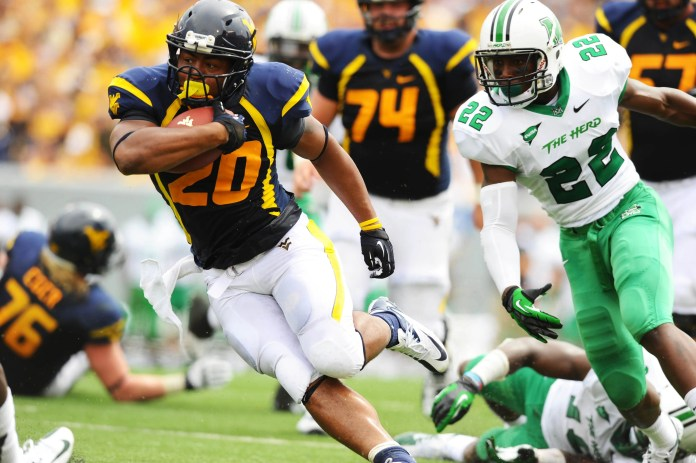 West Virginia Mountaineers running back Shawne Alston (20) carries the ball against Marshall in 2012.