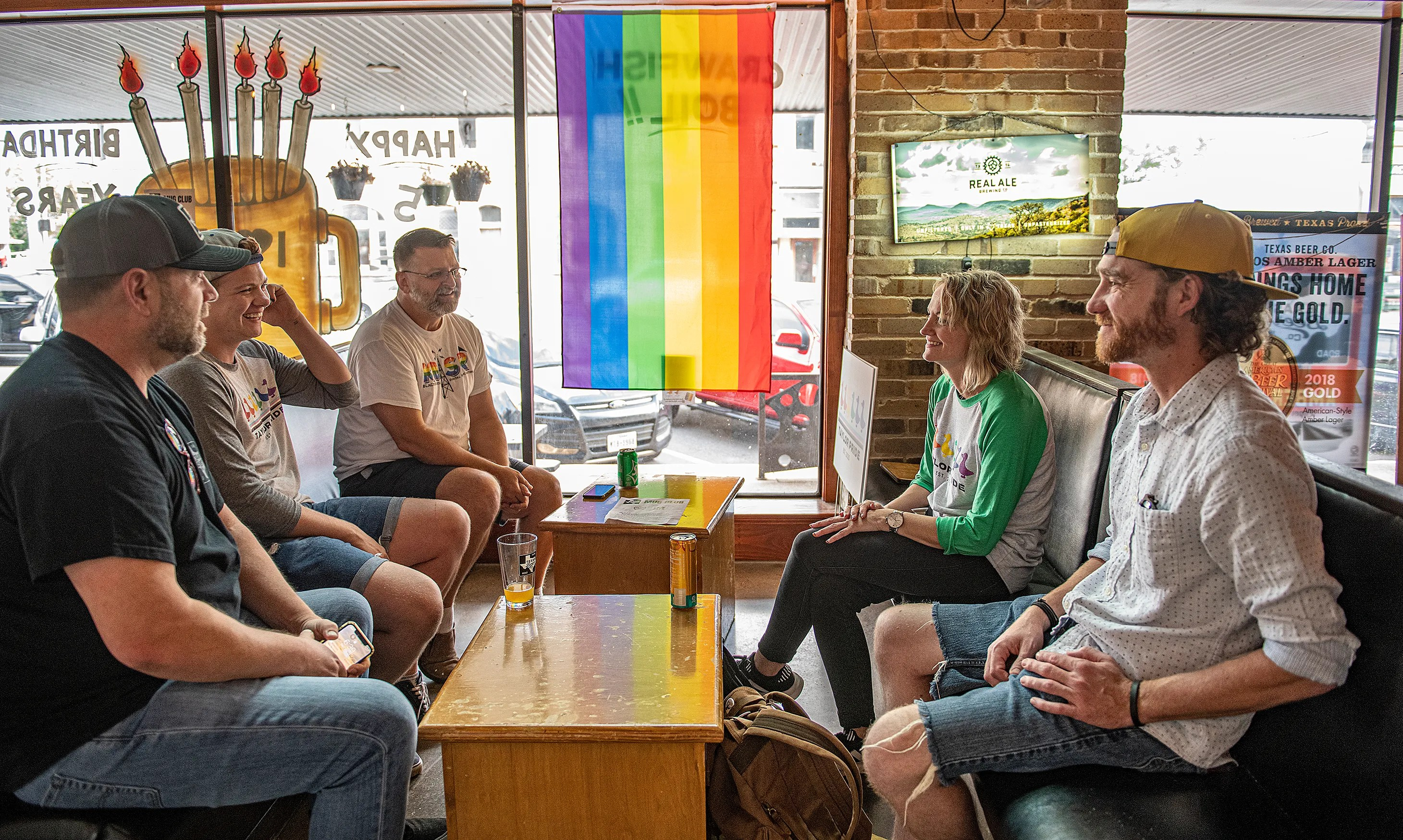 Denise Rodgers, back right, meets Thursday with some of the Taylor Pride Festival's organizing committee, including Ryan Davenport, front right, and at left from front to back, Cort Geis, Red Bailey and Patrick Taylor.