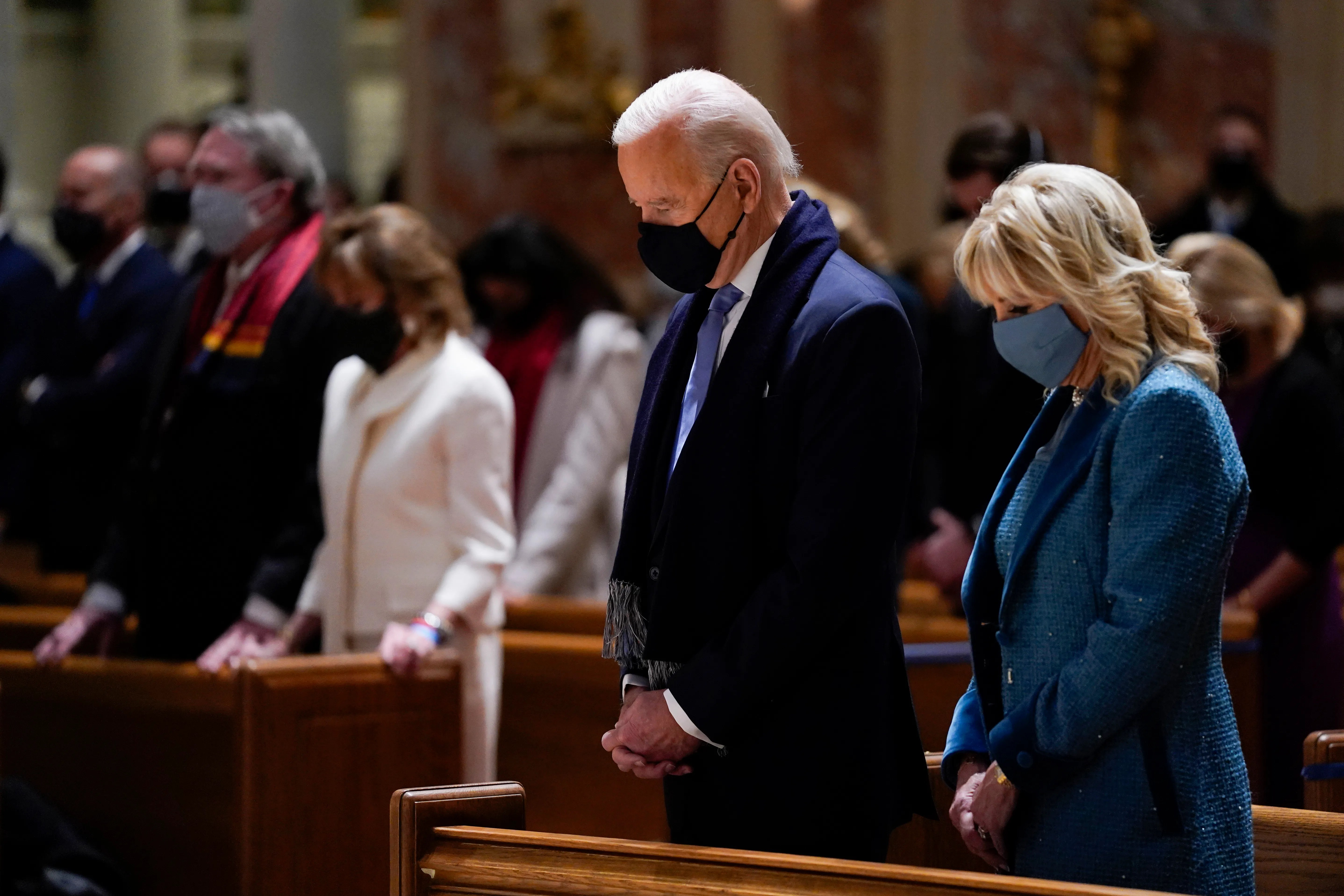 In this Jan. 20, 2021 file photo, President-elect Joe Biden and his wife, Jill Biden, attend Mass at the Cathedral of St. Matthew the Apostle during Inauguration Day ceremonies in Washington.