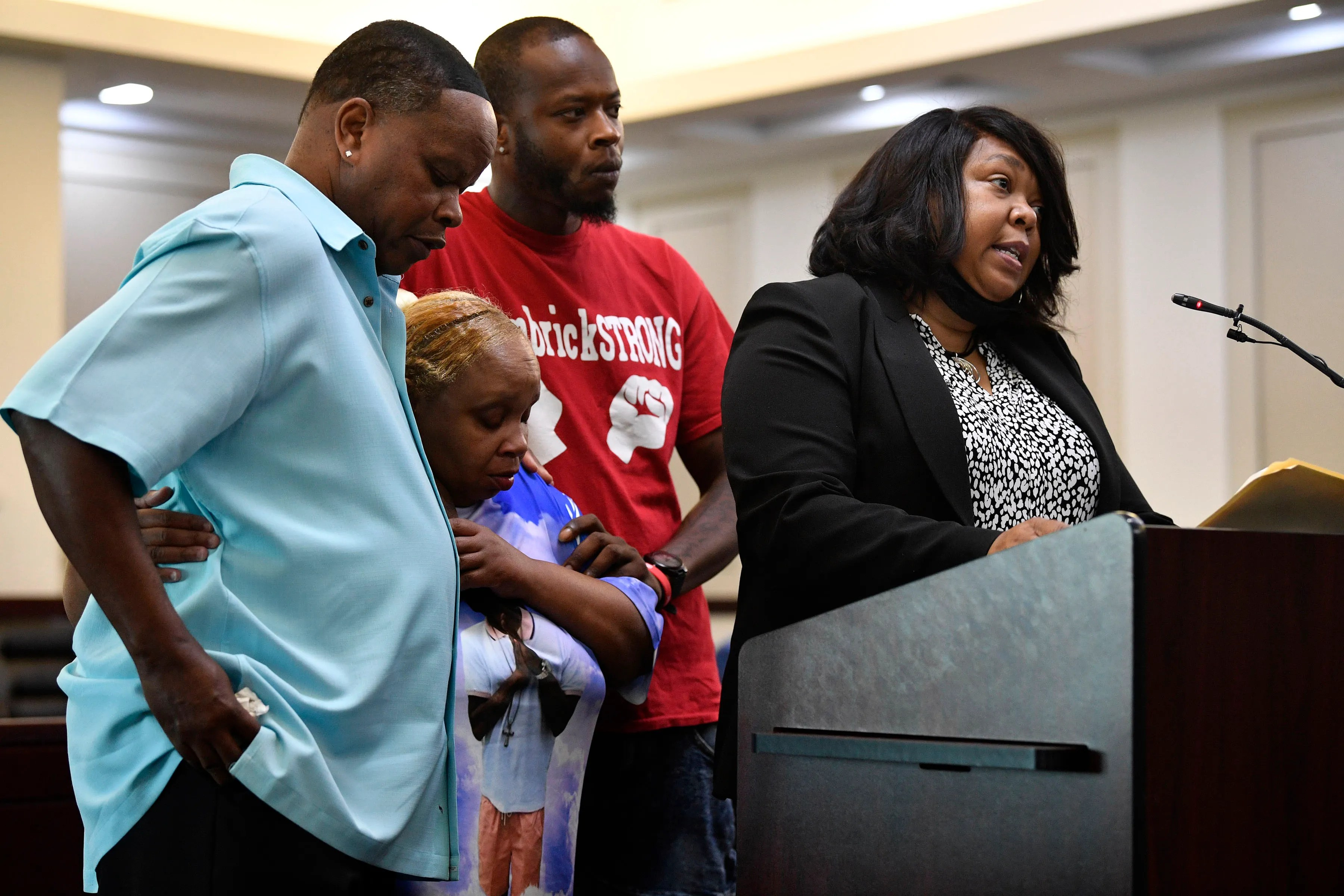 Vickie Hambrick is comforted by family members as their attorney Joy Kimbrough reads victim impact statements in court as Andrew Delke pleads guilty to manslaughter on July 2, 2021, for the 2018 killing of Daniel Hambrick.