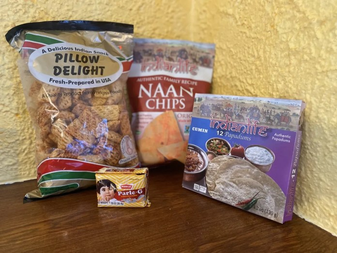 India will bring dozens of athletes to the Olympic Games, and a local grocery will bring plenty of snacks. Pillow Delights, Naan Chips, Parle-G and Papadums are amonth the treats.
