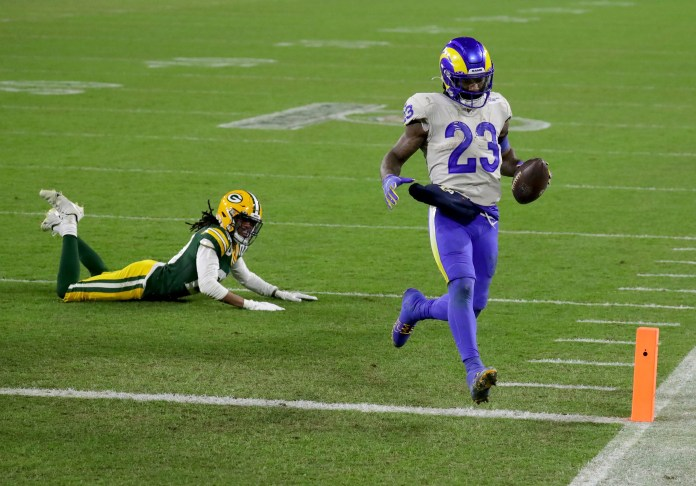 Los Angeles Rams running back Cam Akers (23) runs in the end zone on a 2-point conversion during the 3rd quarter of the Green Bay Packers 32-18 win over the Los Angeles Rams during the NFC divisional playoff game Saturday, Jan. 16, 2021, at Lambeau Field in Green Bay, Wis.