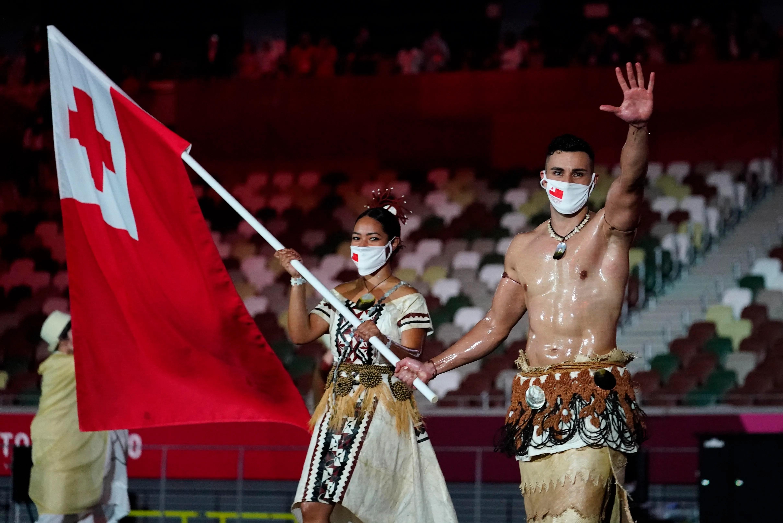 Tonga flag bearers Malia Paseka and Pita Taufatofua during the opening ceremony of the Tokyo 2020 Summer Olympics.