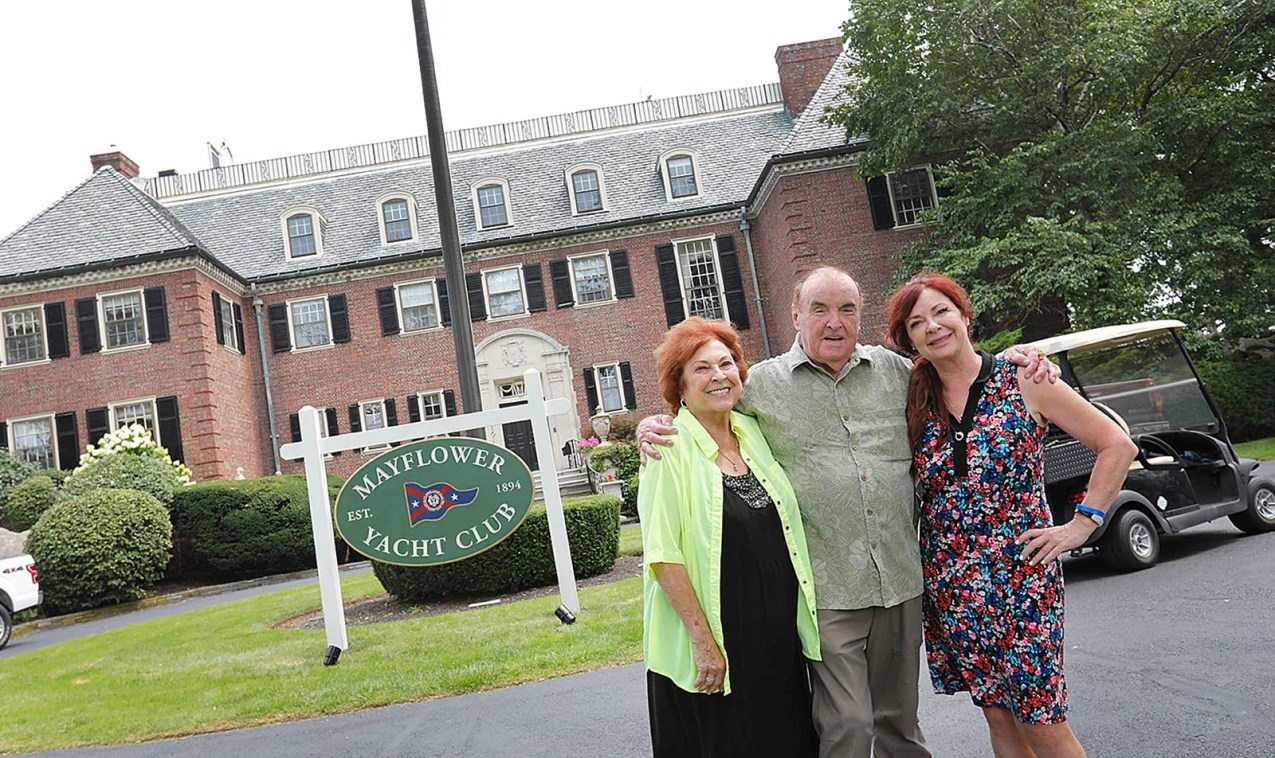 """Judy, Gerald """"Gerry"""" Butler and Suzy Butler Callaghan in front of their summer home in Cohasset, which has been cast as the """"Mayflower Yacht Club"""" for the film """"Confess, Fletch."""""""