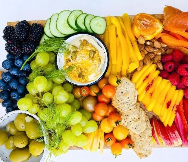 Enjoy a colorful treat with a produce-packed snack board.