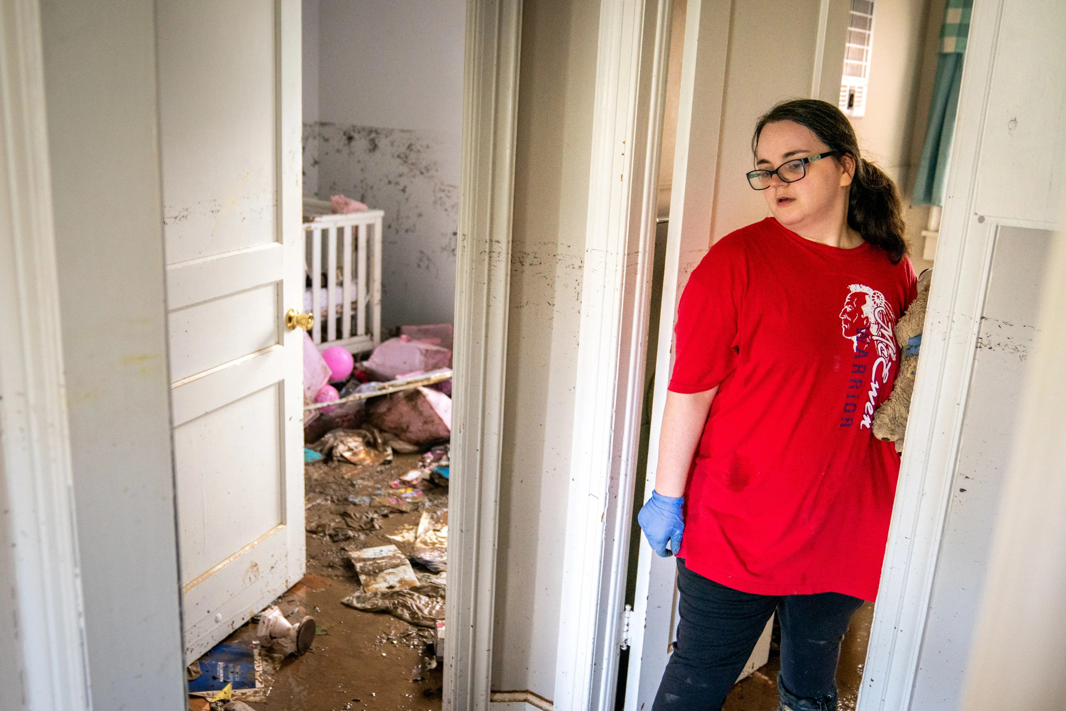 Vanessa Yates checks the damage inside of her home in Waverly, Tenn., Sunday, Aug. 22, 2021. Fifteen inches of rainfall caused substantial flooding in the Humphreys County city.