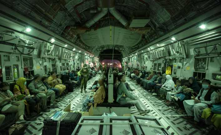 This handout photo, taken on Aug. 20 and received Aug. 22, 2021 from the Australian Defence Force, shows people onboard the Royal Australian Air Force C-17A Globemaster at Hamid Karzai International Airport in Kabul.