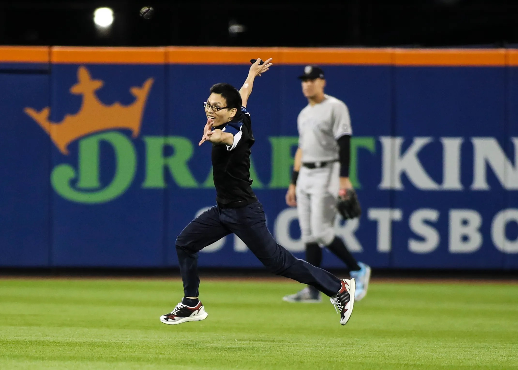 A fan runs onto the field in the sixth inning of the game between the New York Yankees and New York Mets at Citi Field.