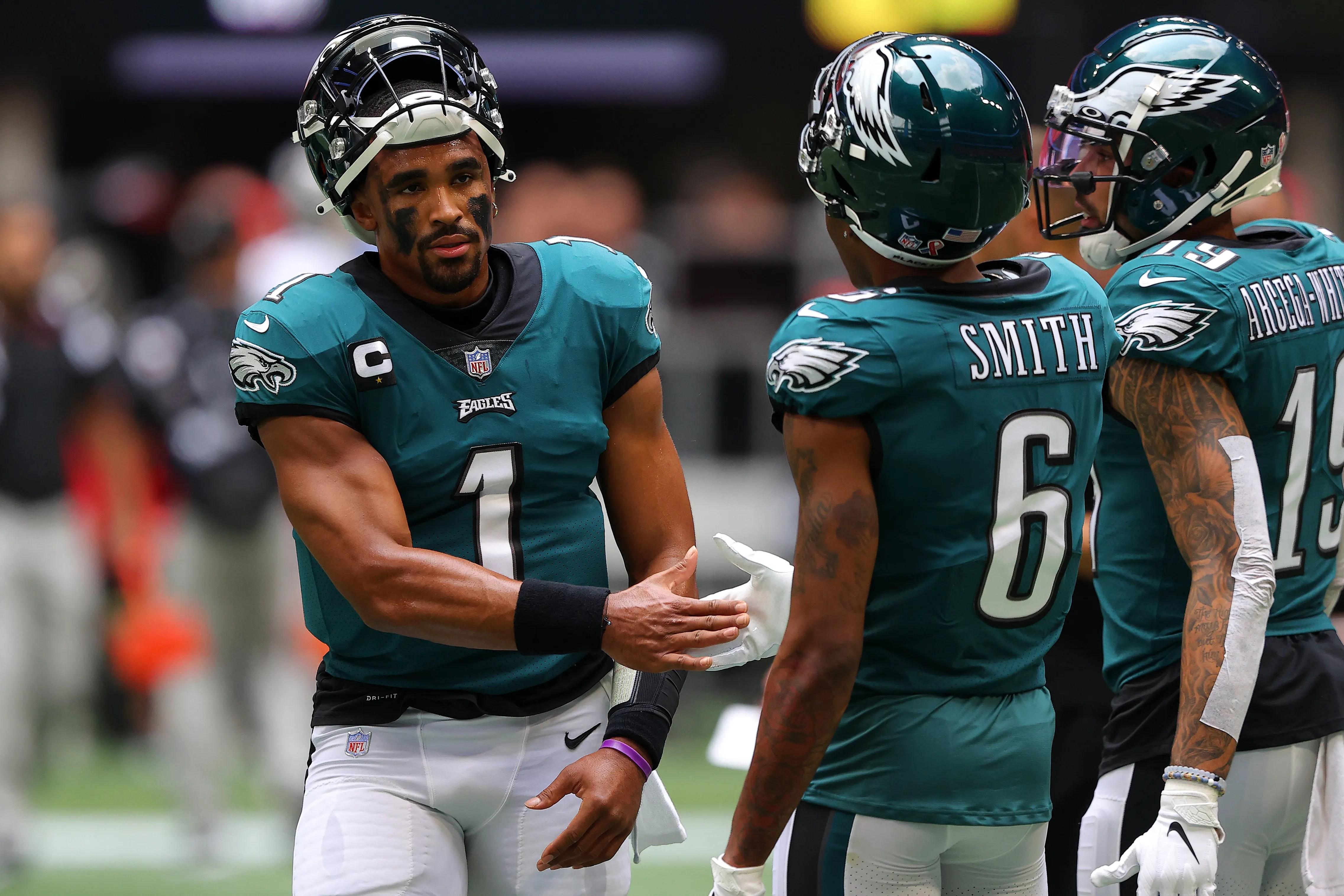 Quarterback Jalen Hurts, left, and wide receiver  DeVonta Smith showed some instant chemistry in the Eagles' opener.