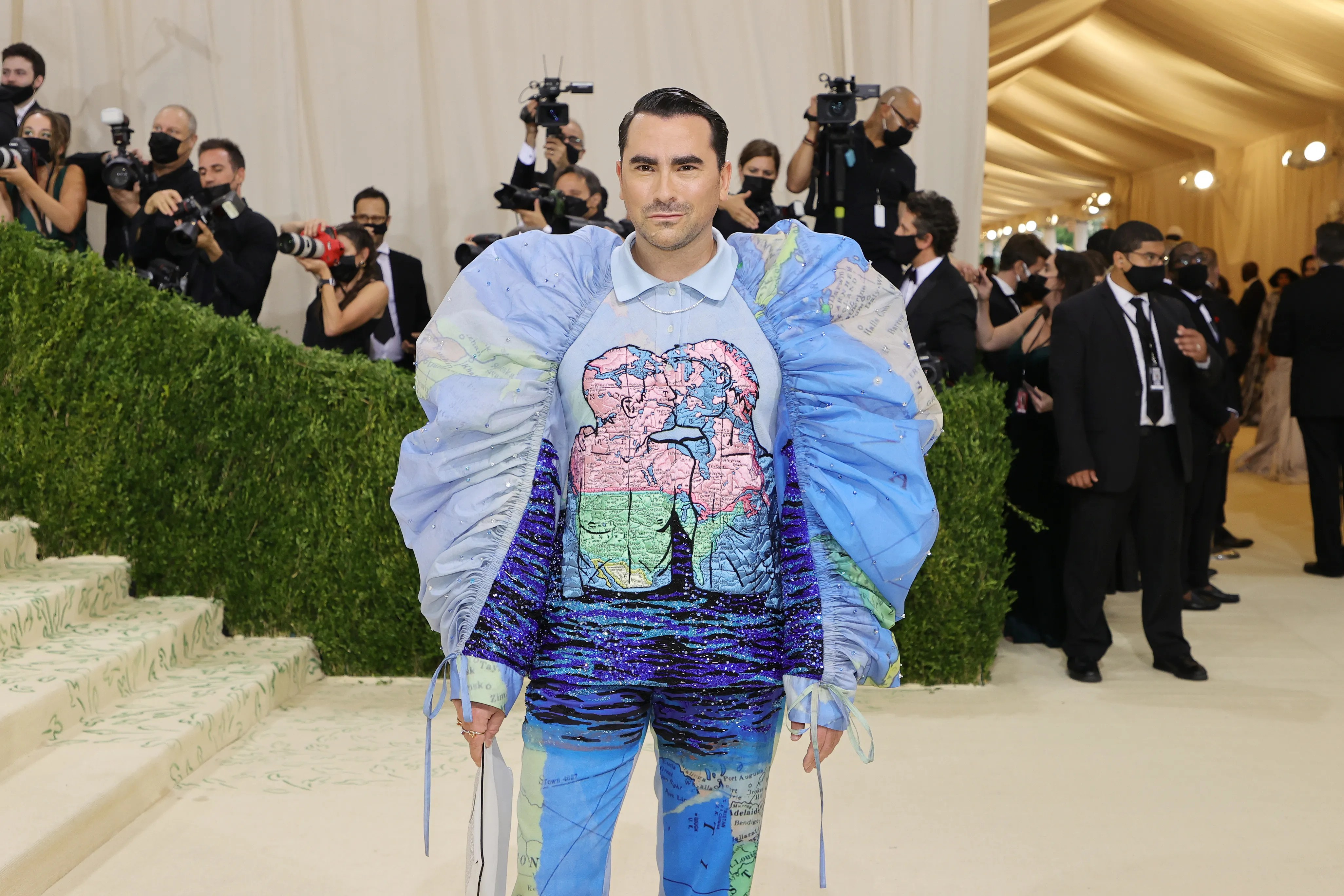 """""""Schitt's Creek"""" star Dan Levyhit the red carpet early in the evening with an outfit from Cartier that putLGBT love front and center, witha cartoon of two men kissing byDavid Wojnarovicz, who died of AIDsin 1992."""