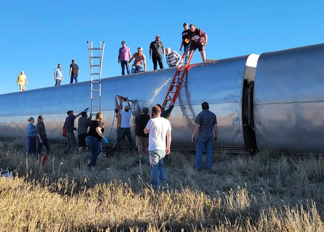 In this photo provided by Kimberly Fossen people work at the scene of an Amtrak train derailment on Saturday, Sept. 25, 2021, in north-central Montana.