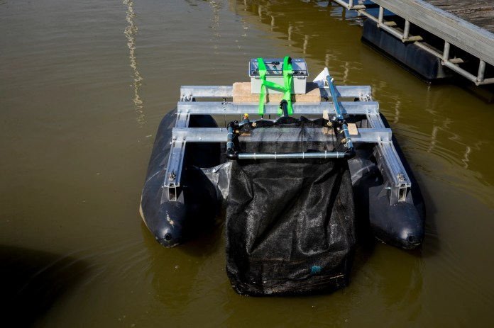 """Clean Earth Rovers' """"Plastics Piranha"""" aquatic rover navigates the Rivertowne Marina in the East End during a test on Thursday, September 30, 2021. Clean Earth Rovers is working to clean marinas to help reduce water pollution. The rover can collect up to 300 pounds of waste per trip."""