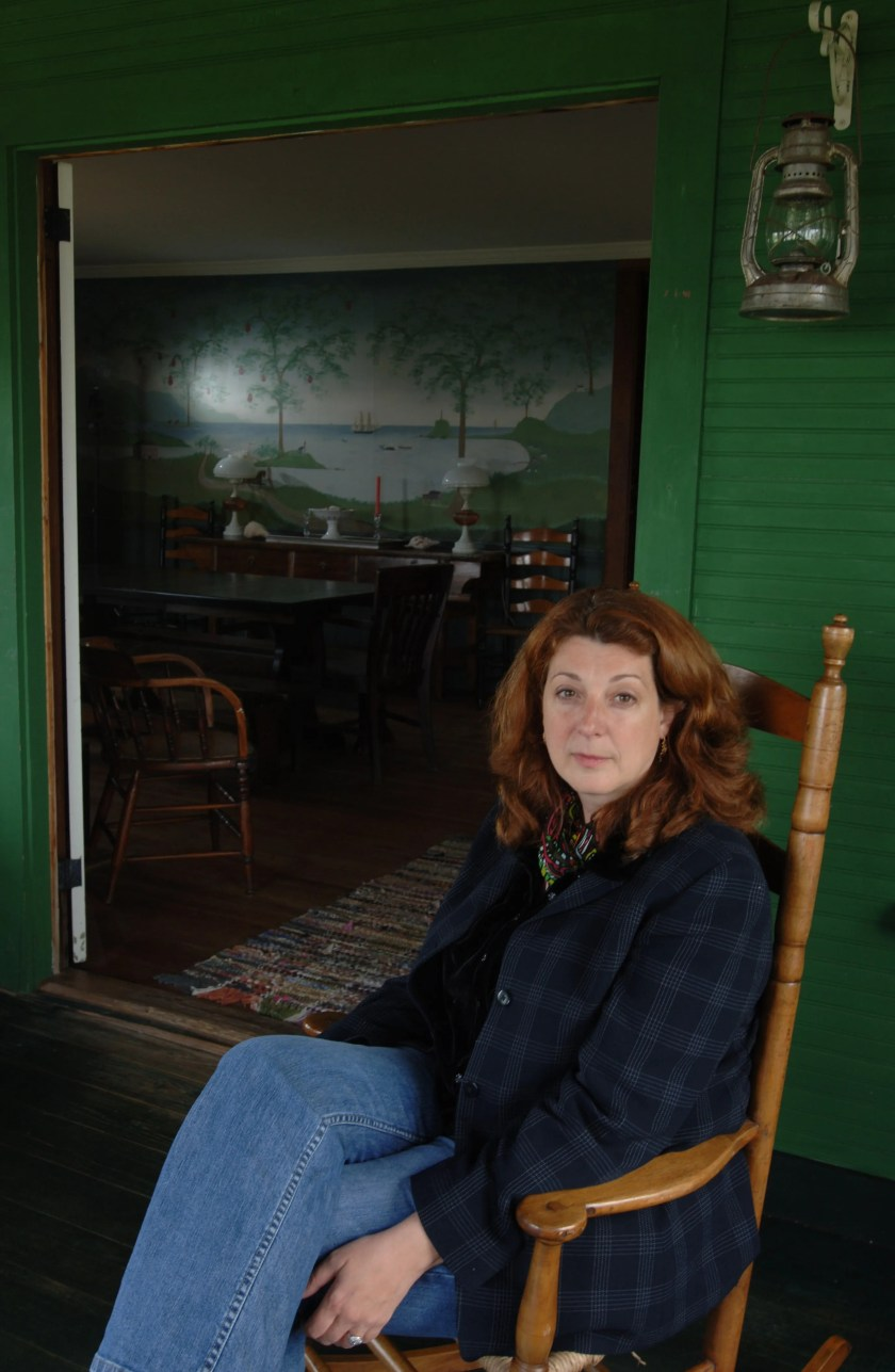 """Director Gwen Wynne at the beach house in Dennis where she filmed the 2007 movie """"Wild About Harry"""" (then known as """"American Primitive""""), which was based on her own adolescence. Her sister painted the mural on the wall for the film."""