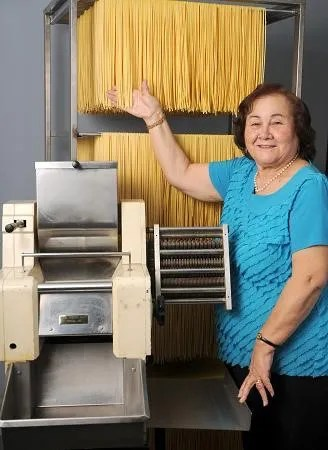 """Tilde Elsa """"Margherita"""" Mucci is pictured in 1986 with her first pasta machine."""