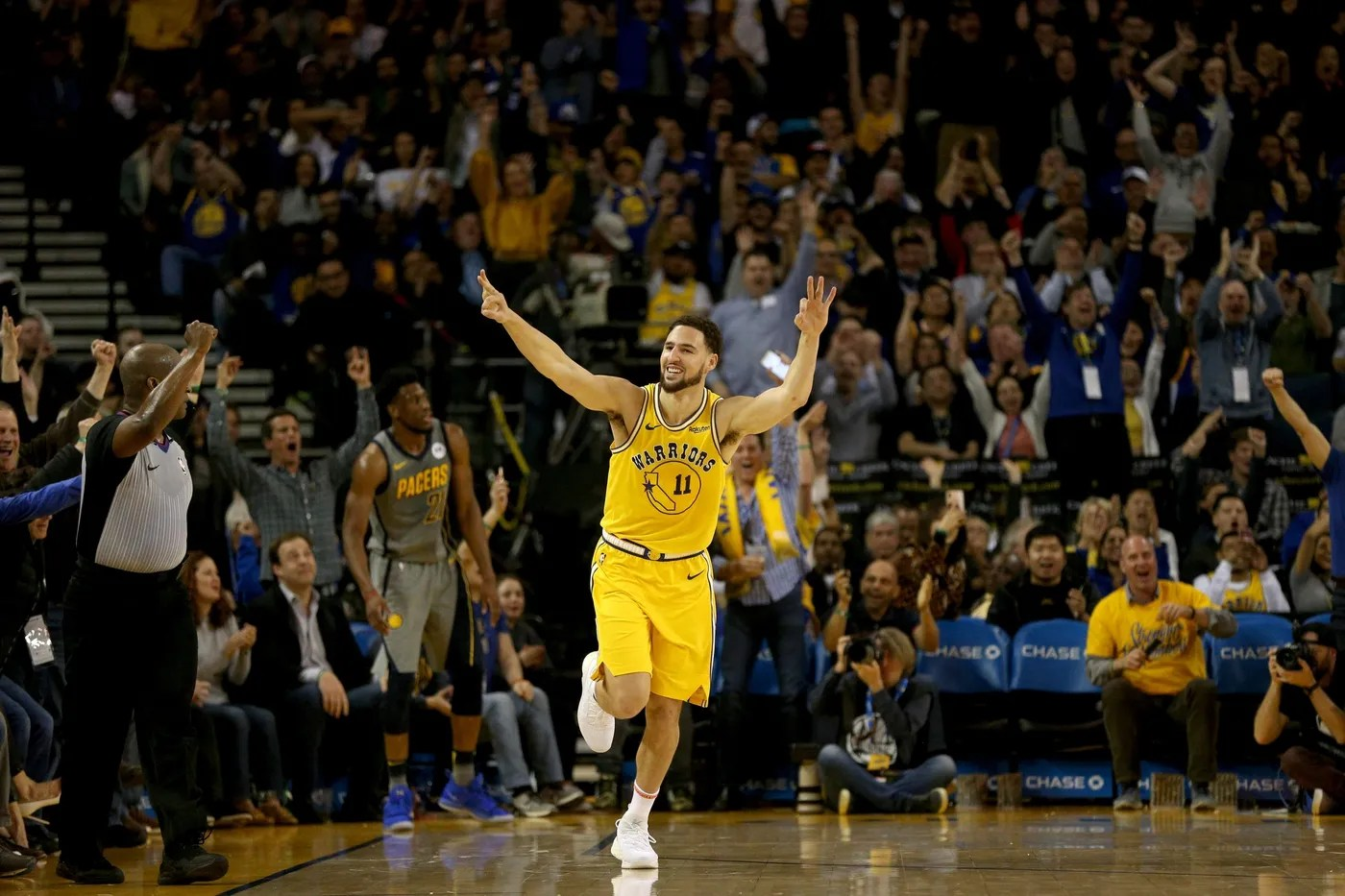 Mar 21, 2019; Oakland, CA, USA; Golden State Warriors guard Klay Thompson (11) reacts after making a three point shot against the Indiana Pacers in the second quarter at Oracle Arena. Mandatory Credit: Cary Edmondson-USA TODAY Sports