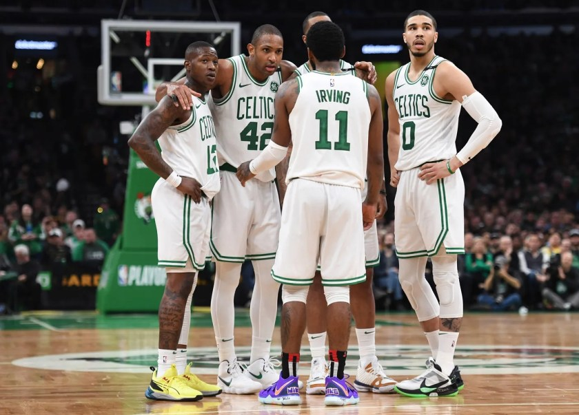 May 3, 2019; Boston, MA, USA; Boston Celtics guard Terry Rozier (12) and center Al Horford (42) and guard Kyrie Irving (11) and forward Jayson Tatum (0) huddle during a time out in the second half in game three of the second round of the 2019 NBA Playoffs against the Milwaukee Bucks at TD Garden. Mandatory Credit: Bob DeChiara-USA TODAY Sports