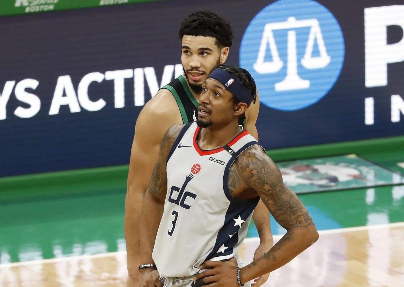 Feb 28, 2021; Boston, Massachusetts, USA; Boston Celtics forward Jayson Tatum (0) talks with Washington Wizards guard Bradley Beal (3) during the second quarter at TD Garden.