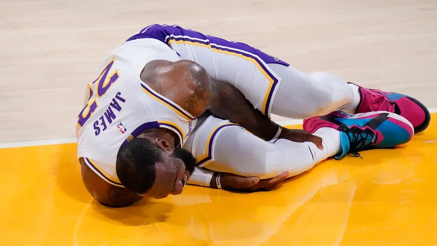 Mar 20, 2021; Los Angeles, California, USA; Los Angeles Lakers forward LeBron James (23) grabs his leg after a collision with an Atlanta Hawks player in the second quarter at Staples Center.