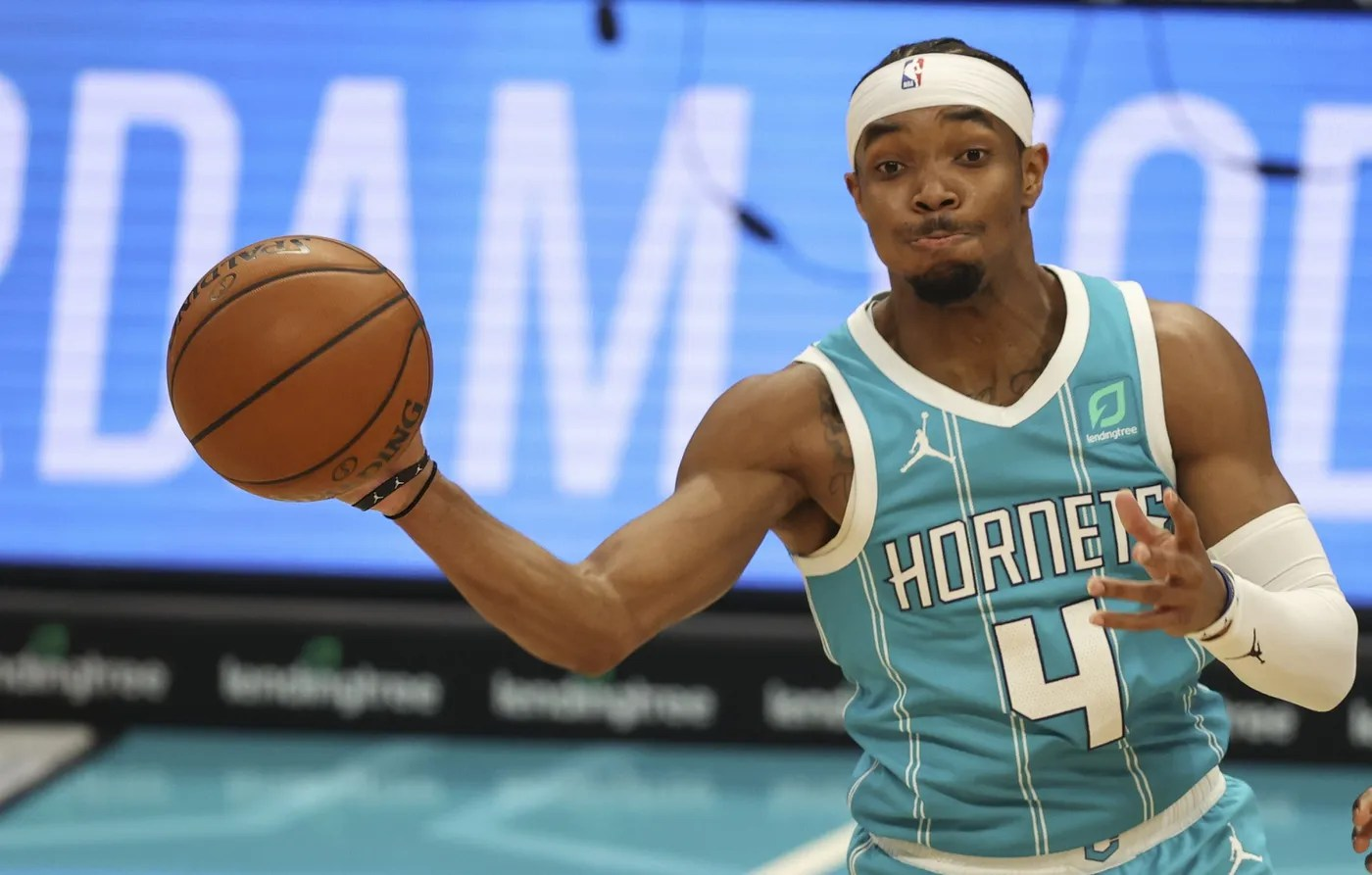 Apr 13, 2021; Charlotte, North Carolina, USA; Charlotte Hornets guard Devonte' Graham (4) passes against the Los Angeles Lakers during the fourth quarter at Spectrum Center. The Los Angeles Lakers won 101-93.