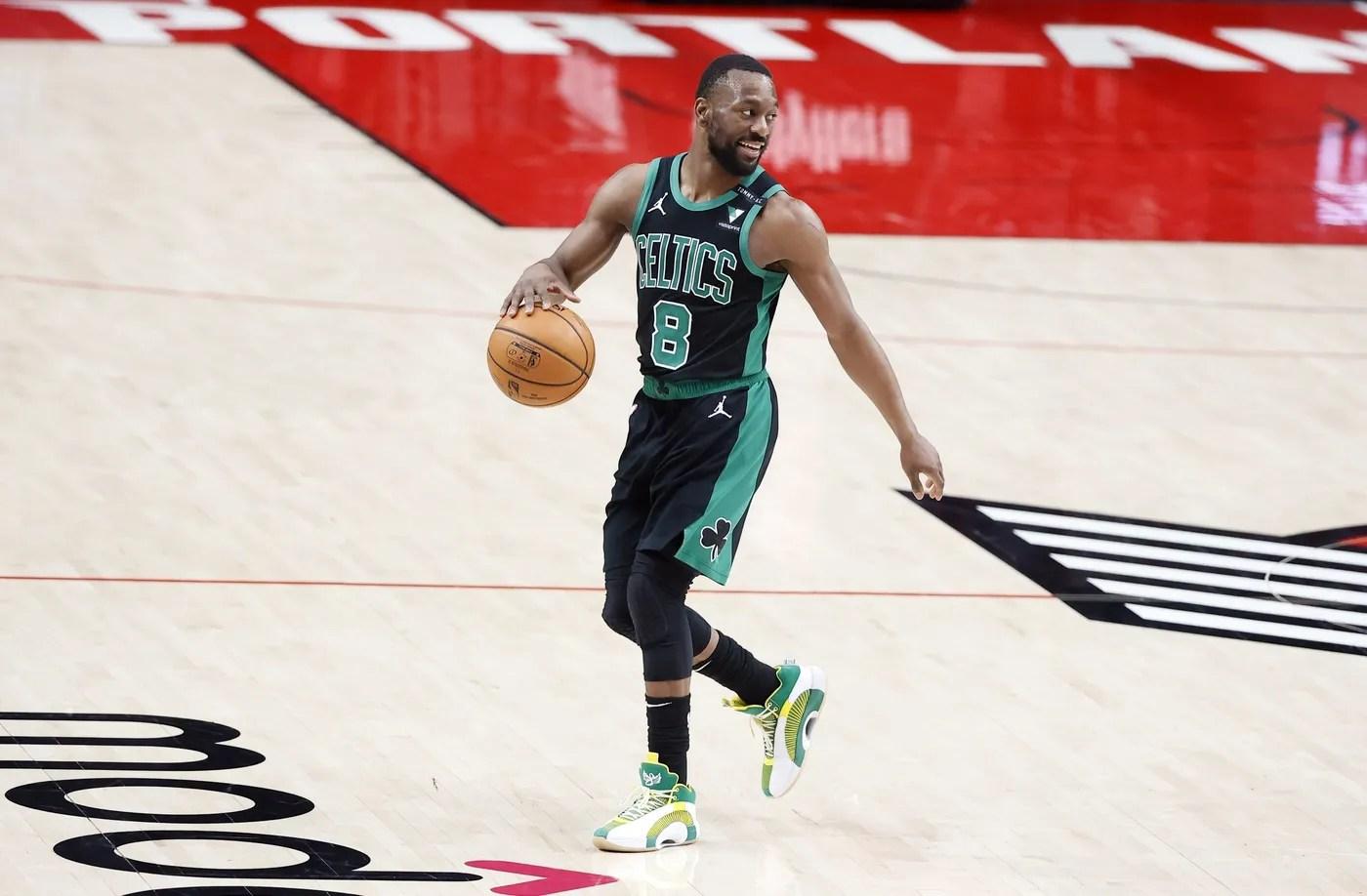 Apr 13, 2021; Portland, Oregon, USA; Boston Celtics point guard Kemba Walker (8) controls the ball against the Portland Trail Blazers during the second half at Moda Center.