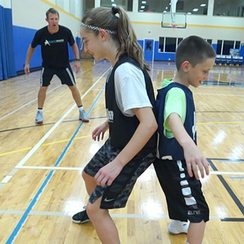 Ganon Baker Basketball Training and Development training two kids