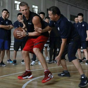 Ganon Baker training a group of basketball coaches during Live Training in China