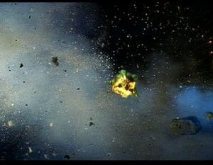 A flaming Starbug flying through wreckage