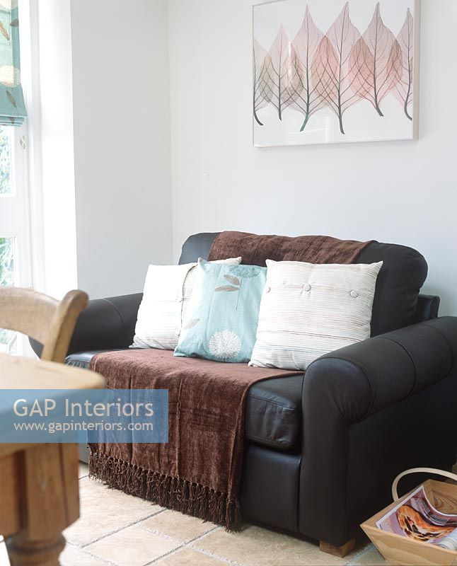 GAP Interiors Assorted Cushions And Throw On Leather Two Seater