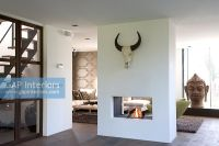GAP Interiors - Central fireplace in modern living room ...