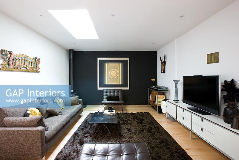 GAP Interiors  Contemporary living room with black
