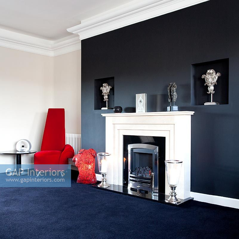 GAP Interiors  Modern living room with black feature wall