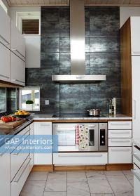 GAP Interiors - Modern kitchen with slate feature wall ...
